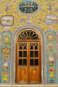 Golestan Palace, Tehran  The oldest of the historic monuments in Tehran, the Golestan Palace (also Gulistan Palace) (The Rose Garden Palace) belongs to a group of royal buildings that were once enclosed within the mud-thatched walls of Tehran's Historic Arg (citadel). The Arg was built during the reign of Tahmasp I (r. 1524-1576) of the Safavid dynasty (1502-1736), and was later renovated by Karim Khan Zand (r. 1750-1779). Agha Mohamd Khan Qajar (1742-1797) chose Tehran as his capital. The Arg became the site of the Qajar (1794-1925). The Court and Golestan Palace became the official residence of the royal Qajar family. The palace was rebuilt to its current form in 1865 by Haji Abol-hasan Mimar Navai. During the Pahlavi era (1925-1979) Golestan Palace was used for formal royal receptions and the Pahlavi dynasty built their own palace at Niavaran. The most important ceremonies held in the Palace during the Pahlavi era were the coronation of Reza Khan (r. 1925-1941) in Takht-e Marmar and the coronation of Mohammad Reza Pahlavi (r. 1941-deposed 1979) in the Museum Hall. In between 1925 and 1945 a large portion of the buildings of the palace were destroyed on the orders of Reza Shah who believed that the centuries old Qajar palace should not hinder the growth of a modern city. In the place of the old buildings modern 1950s and 1960s style commercial buildings were erected.