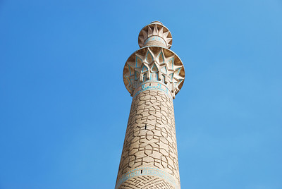 Once part of a caravansarei, this minaret is now part of a quiet suburban setting.