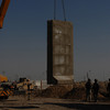A T-wall is being moved into position during the construction of Joint Security Station Basateen in Baghdad's Adhamiyah district, Dec. 9.  Multi-National Division – Baghdad Soldiers from the 1st Combined Arms Battalion, 68th Armor Regiment, 3rd Brigade Combat Team, 4th Infantry Division are moving to the JSS from a larger nearby base which is slated to close.<br /> (U.S. Army photo by Sgt. Jerry Saslav, 3rd BCT PAO, 4th Inf. Div., MND-B)