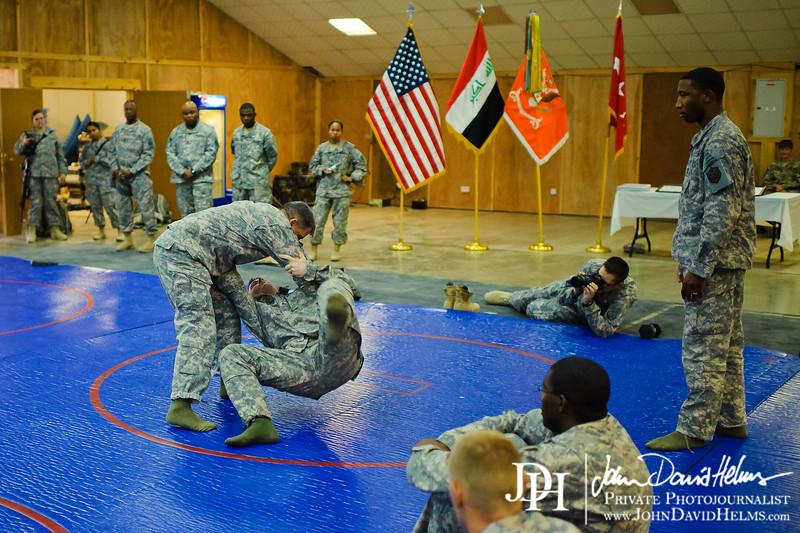 1 JUL 2011 - LTG Ferriter (USF-I DCG A&T), SFC Nicholson, and SSG Wilshire demonstrate MACP techniques during a Basic Combatives Course graduation.  Hope Chapel, VBC, Baghdad, Iraq.  Photo by John D. Helms - john.helms@iraq.centcom.mil.