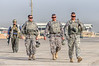 30 SEP 2011 - LTG Ferriter and LTG Caslen walk toward their planes at Sather Air Base, Victory Base Complex, Baghdad, Iraq. U.S. Army photo by John D. Helms - john.helms@iraq.centcom.mil.