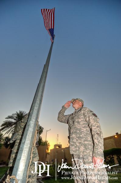 1 SEP 2011 - MAJ Patrick Flynn raises and salutes the U.S. flag outside building one, FOB Union III, Baghdad, Iraq. U.S. Army photo by John D. Helms - john.helms@iraq.centcom.mil.