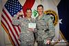01 SEP 2011 - RADM Winters promotes USAF Cpt Stringer to Major.  Building one, FOB Union III, Baghdad, Iraq. U.S. Army photo by John D. Helms - john.helms@iraq.centcom.mil.
