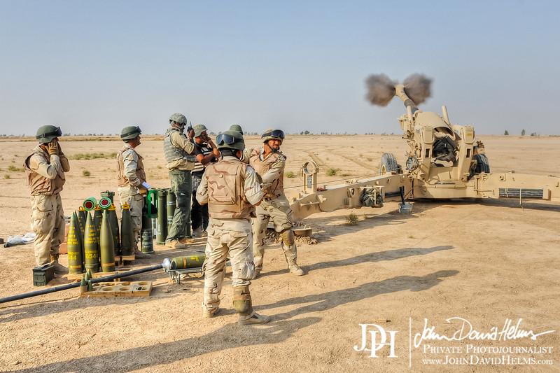 16 OCT 2011 - BG Roberts, COL Romero and other leaders observe Howitzer live fire training in Besmaya, Iraq.  U.S. Army photo by John D. Helms - john.helms@iraq.centcom.mil.
