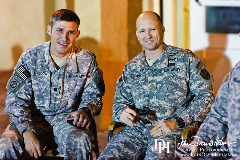 12 NOV 2011 - OSC-I Chief and NTM-I Commander LTG Robert L. Caslen, Jr. and OSC-I CSM George Manning enjoy cigars on the patio of BLDG One with other OSC-I leadership.  FOB Union III, Baghdad, Iraq.  Photo by John D. Helms - john.helms@iraq.centcom.mil.