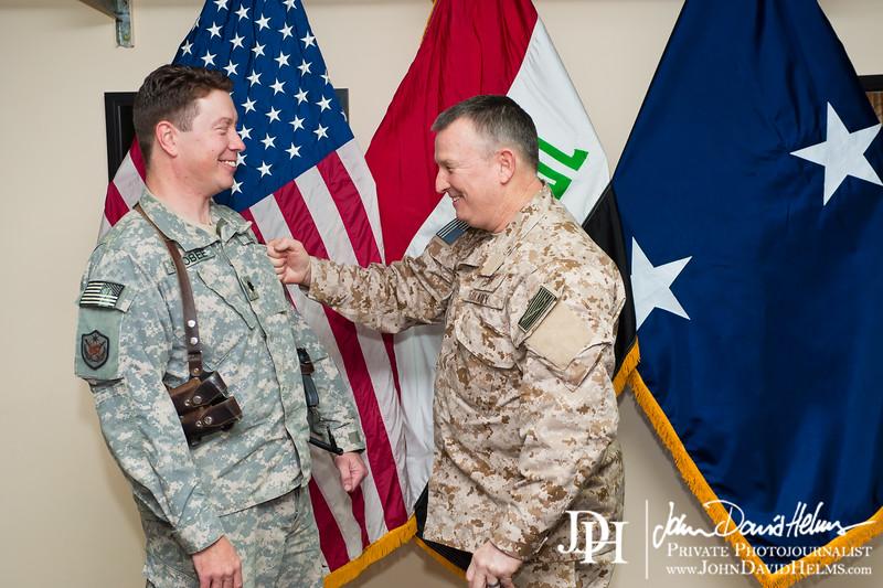 4 DEC 2011 - CDR Scobee promotion ceremony at BLDG One, FOB Union III, Baghdad, Iraq.  Photo by John D. Helms - john.helms@iraq.centcom.mil.