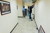 3 DEC 2011 - Almco workers hang framed photos inside BLDG One at FOB Union III, Baghdad, Iraq.  Photo by John D. Helms - john.helms@iraq.centcom.mil.