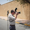 July 2011 - USF-I DCG A&T Photographer John D. Helms at work; FOB Union III, Baghdad, Iraq.  Photo courtesy of NTM-I PAO.