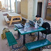 2 SEP 2011 - Sather Air Base, VBC, Baghdad, Iraq. After the 'all clear' we headed over to the USO tent for wireless access.  Sat there for a couple of hours (we were also waiting for someone at the office to send me my 'control number' for my leave form).  I had brought all my paperwork with me, but the copy of the leave form that I brought didn't have a control number on it (of course).  U.S. Army photo by John D. Helms - john.helms@iraq.centcom.mil.