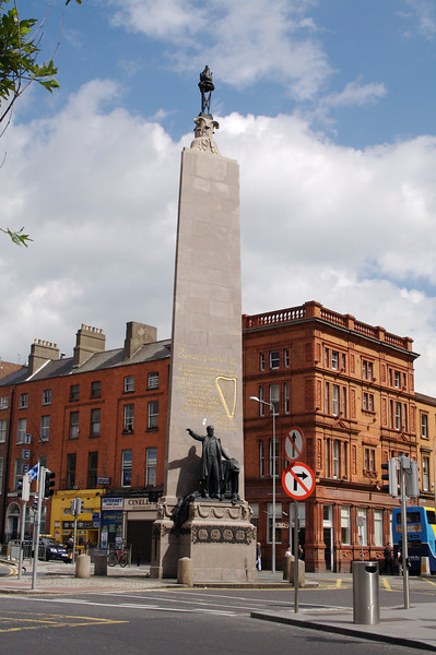 Monument to Charles Stuart Parnell, who blew Ireland's chance for independence in the 19th century with a sex scandal. At the top of O'Connell Street in the sunshine.