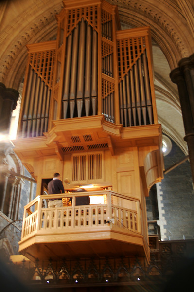 For its first several hundred years Christchurch was burdened with a very flawed organ, but it now proudly sports a modern, world class instrument.  The organist was experimenting, playing the same few bars repeatedly using  different stops