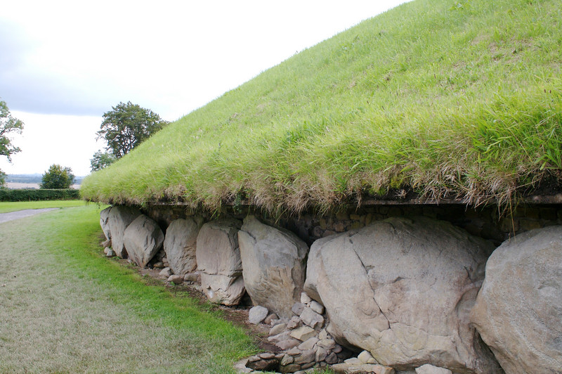 Knowth tomb, at Bru na Boinne.  Each stone weighs several tons, and most have engravings.  Nearby Newgrange has a interior chamber, intact for 5,000 years, which you visit.  It receives sunlight one day a year.