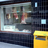 Butcher shop in Dingle town on Dingle peninsula - lunch and the inevitable shopping.<br /> Interesting markings on the hanging carcasses.