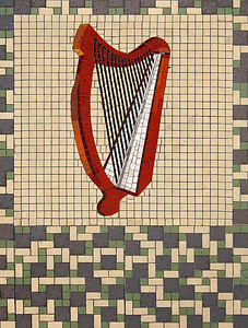 Mosaic floor tiles in front of a shop, Dublin