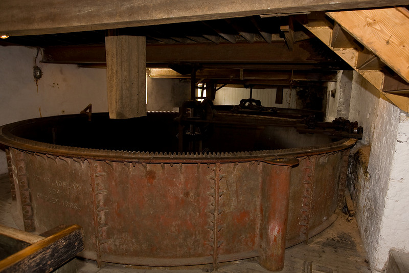 This is a mash tun where the cracked barley was mixed with hot water and stirred constantly producing the mother liquor.