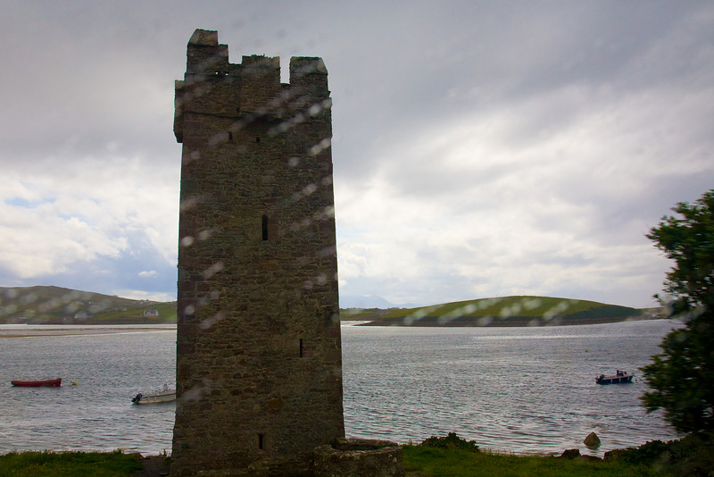 """The next day we were off to Achill Island.  We passed through an area that Matthew described as Grace O'Malley country.  This was one of the four story look out towers used by the """"Pirate Queen"""" taken through the bus window while it was raining."""