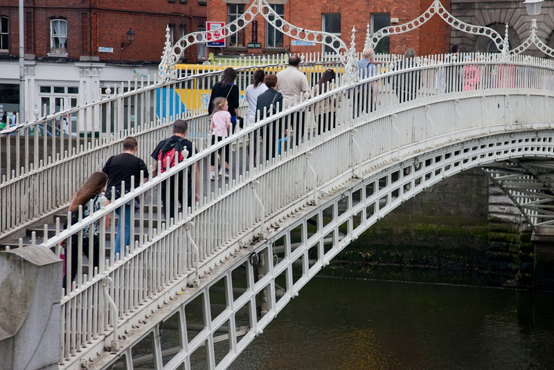 This is the famous Halfpenny Bridge over the river Liffey, Dublin.  The bridge was erected in 1816 and there was a toll of one half penny to cross.