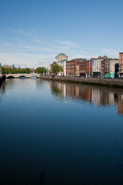 The Liffey river with the four courts in the distance.  On foot in Dublin.