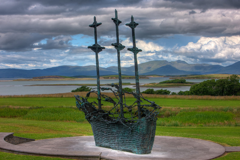 Across from the entrance of Croag Patrick, there is a monument of the Coffin Ship commemorating those who died immigrating from Ireland during the famine.  This is an HDR (high dynamic range) rendering of the site.