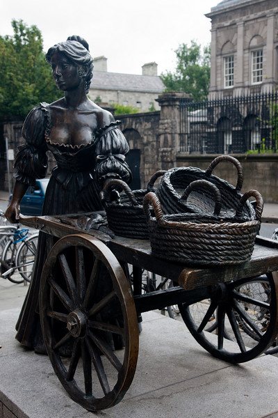 """No tour of Dublin would be complete without a photo of Molly Malone.  Molly Malone statue in Grafton Street, was unveiled by then Lord Mayor of Dublin, Alderman Ben Briscoe during 1988 the Dublin Millennium celebrations, declaring June 13 as Molly Malone Day.  """"Molly Malone"""" (also known as """"Cockles and Mussels"""" or """"In Dublin's Fair City"""") is a popular song, set in Dublin, Ireland, which has become the unofficial anthem of Dublin City. It has also in Ireland acquired the status of an Irish anthem."""