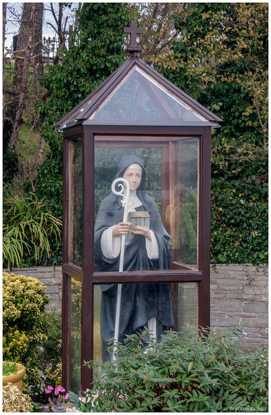 The Holy Shrine of Saint Brigid, one of Ireland's three patron saints.<br /> <br /> On St. Brigid's Eve, as night fell,<br /> My mother and I went to Saint Brigid's Well<br /> Where the candles do burn and the great walls do shine<br /> On the graves of the dead and the vaults of O'Brien