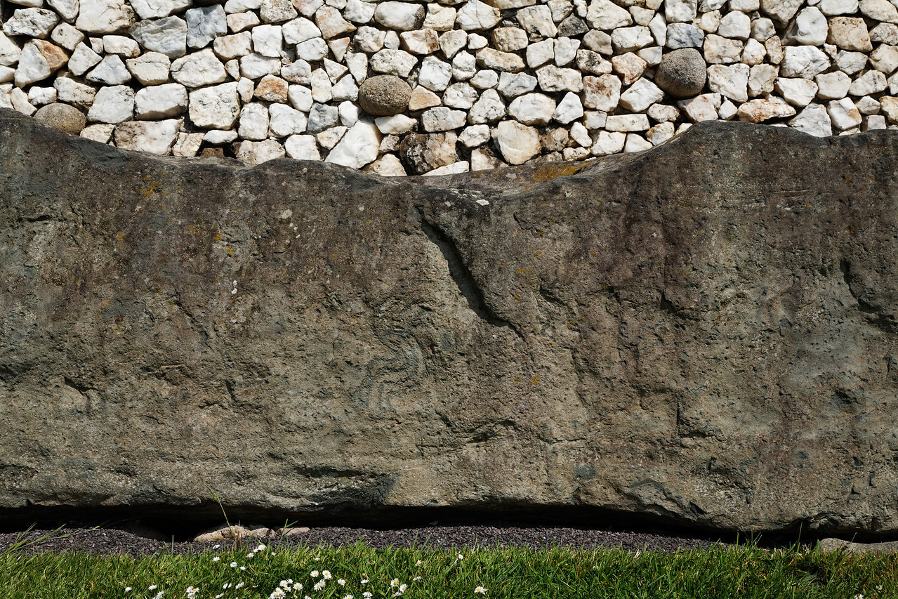 Wall and curb stone, Newgrange