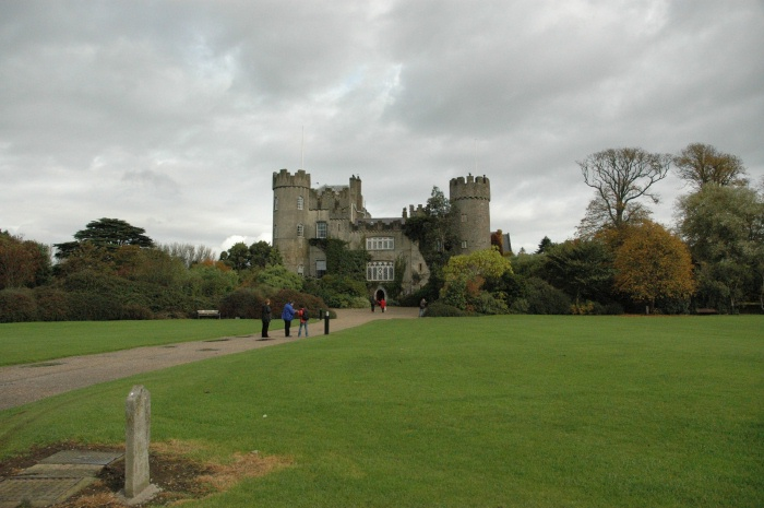 The front side of Malahide Castle and the pathway leading to it