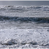 Beside the shoreline with my camera. That wave overtook me and soaked me to the knees.
