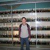 Dave in front of the wall of Guinness bottles.