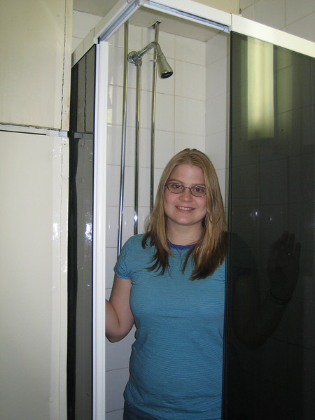 Heather in the smallest shower that either of us has ever seen.