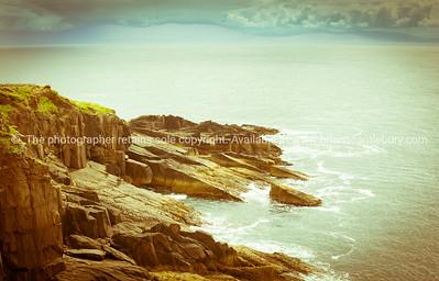 Rocky cliffs along Wild Atlantic Way tourist route on Irish west coast