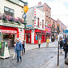 Bars, shops and tourists in Temple Bar area of city.