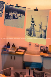 Inside an old darkroom with developed photos hanging drying