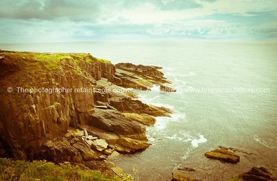 Rocky cliffs along Wild Atlantic Way tourist route on Irish west coast