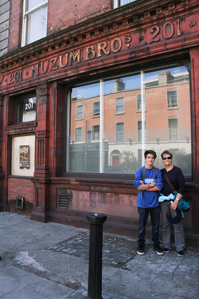Nuzum Brothers!  (?)  Mary & Dakota in front of closed store...