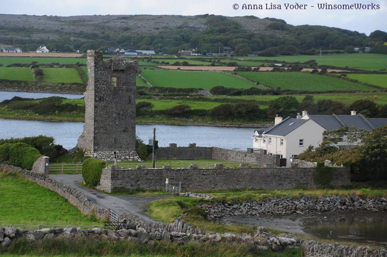 View of Shanmuckinish Castle ruins & peninsula of Finavarra Demesne, County Galway