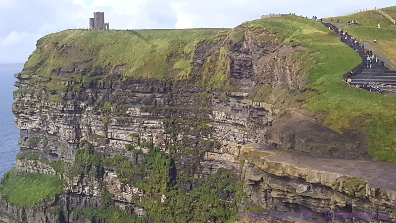 Telephoto view of Cliffs of Moher with O'Brien's Castle on cliff-top