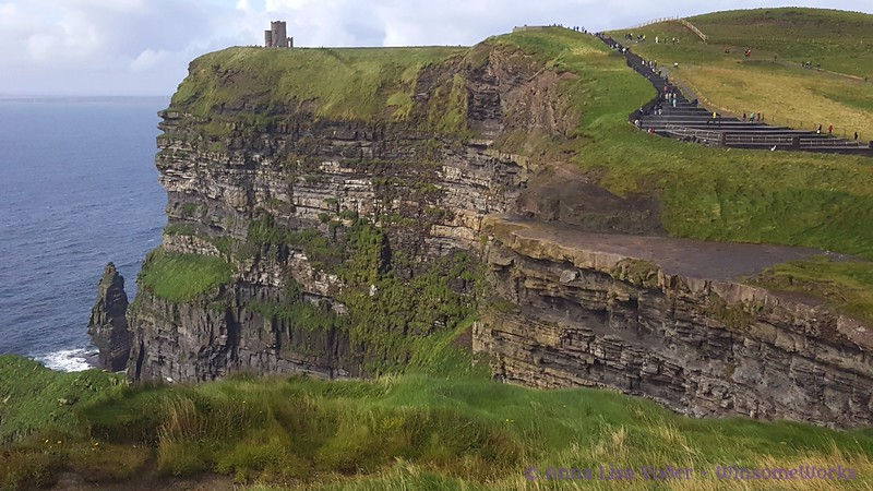 Telephoto view of Cliffs of Moher, looking North. Branounmore Sea Stack is the pointed rock. O'Brien's Castle is on clifftop