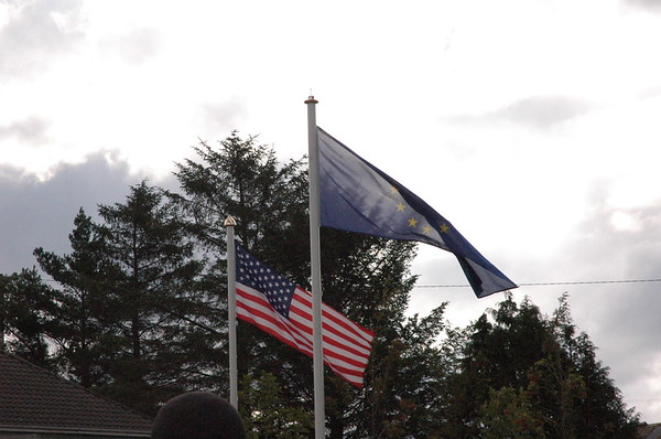 The US flag flying next to the European Union flag.