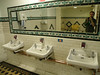 Men's lavatories, National Library of Ireland.  Note the easy chair and table.