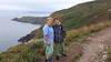Xavier &  me on Howth Head with Baily Lighthouse & coast of Wicklow in background - from Cliff Path near Cannon Rock