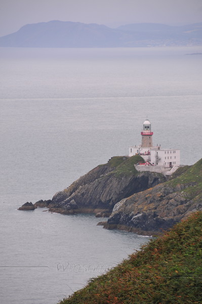 Baily Lighthouse telephoto from near Cannon Rock (coast of Wicklow can be seen in background)- Cliff Path, Howth