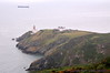 Baily Lighthouse  and ship in Irish Sea, seen from Cliff Path