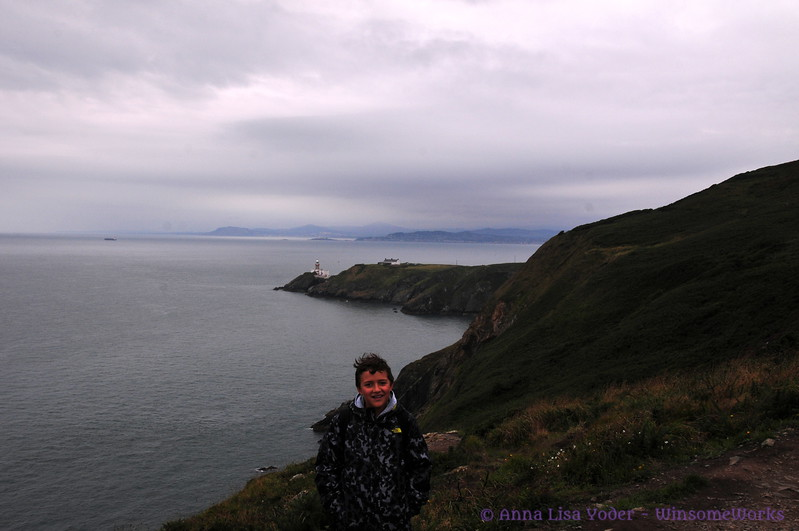 Xavier on Howth Head with Baily Lighthouse & coast of Wicklow in background - from Cliff Path near Cannon Rock