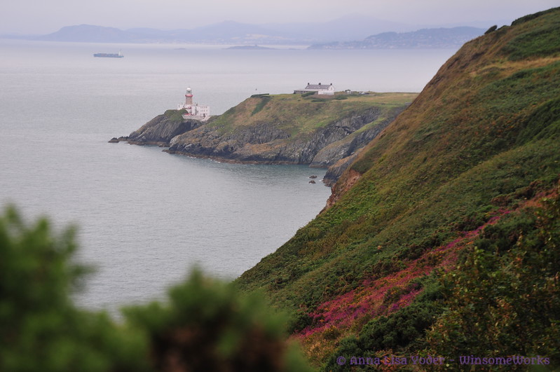 Baily Lighthouse telephoto from near Cannon Rock (coast of Wicklow in background)- Cliff Path, Howth