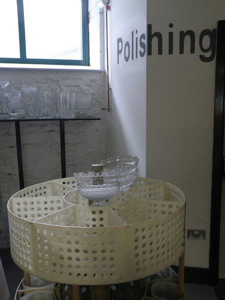 """Waterford Crystal factory tour; """"defrosting"""" (e.g., the """"frosted"""" vase on the left gets converted to the """"crystal"""" vase on the right) happens elsewhere, with alternate dipping in a sulfuric acid solution and in water."""
