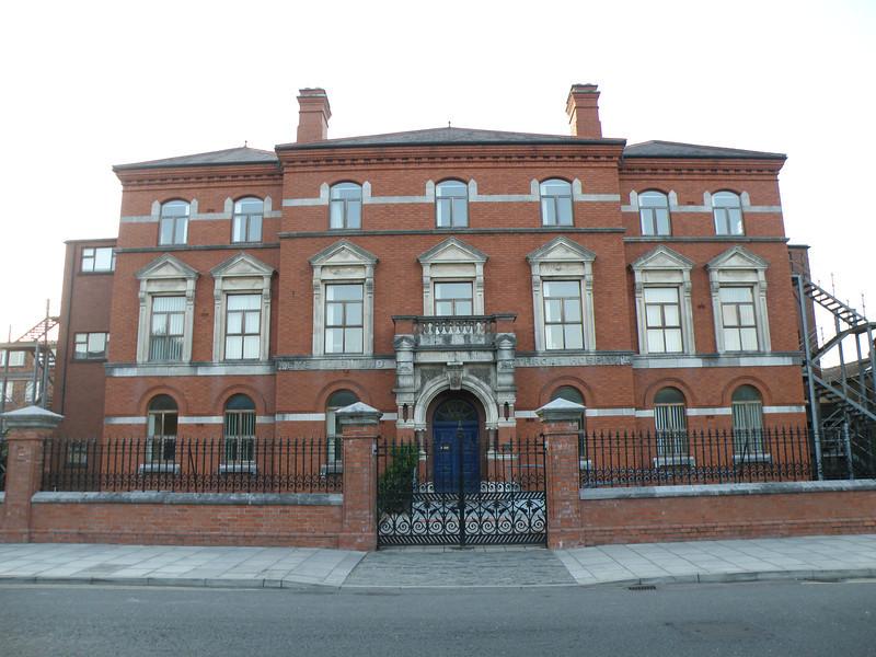 A seven-bay, three-storey building in Cork, Ireland.