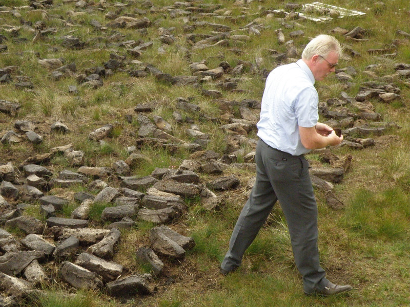 Our intrepid tour guide Jim retrieving a sample block of peat.