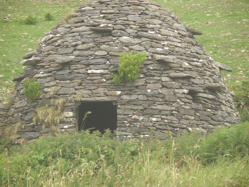 Beehive stone hut, Dingle peninsula.  Note the steps for climbing on top of the hut.
