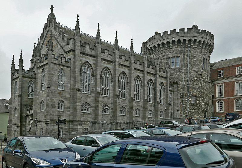 Dublin Castle. The following two images are located above the doorway, which is barely visible at the left end of the building.